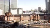 4K Motion controlled pan left time lapse footage with zoom in motion of historic Tokyo Station during the daytime in Japan