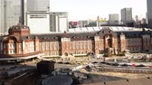4K Motion controlled pan left time lapse footage with zoom in  out motion of historic Tokyo Station during the daytime in Japan