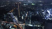 4K Time lapse footage with tilt up motion of metropolitan cityscape from day to night shot atop Sunshine 60 in Ikebukuro, Tokyo, Japan
