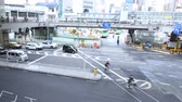 negócio : 4K Motion controlled pan right  tilt up time lapse footage of a busy intersection in Shibuya, Tokyo, Japan