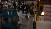 negócio : Footage of workers at Tsukiji Fish Market district in Tokyo, Japan -long shot-