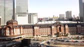 4K Motion controlled pan left time lapse footage with zoom out  motion of historic Tokyo Station during the daytime in Japan