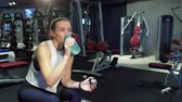 programm : The cute girl drinks water in a break between training sessions Stock Footage