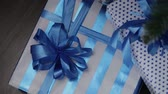 ribbon : Christmas Present Boxes under the Christmas tree Stock Footage