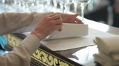 dobrado : Female hands folding napkins. Waiter folding napkin at restaurant. Close up