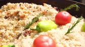 pork meat : Fragrant delicious pilaf with beef, tomates and large pepper in a huge cauldron. Street festive freshly prepared food. Delicious rice. Meat and rice. Healthy food. A traditional dish of Asian cuisine