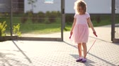 windy : Girl jumping rope on the Playground. Stock Footage