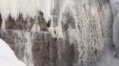 frozen waterfalls : Waterfall among ice on the river in spring, Bugotak River, Novosibirsk, Russia