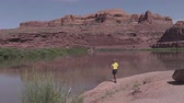 america : Tourist Admiring the Colorado River by Moab Utah