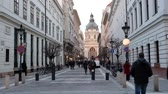 BUDAPEST, HUNGARY- JANUARY,2019: People going along the street at St Stephans Basilica