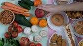 hambúrguer : Concept shot of healthy and unhealthy food. Fruits and vegetables vs fast food. Somebodys hand choosing.
