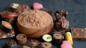 trufas : Assorted chocolate and cocoa on black background, close up. High angle view Vídeos