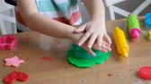 školka : Lovely 4 years boy with playing at home. Hands close up Dostupné videozáznamy