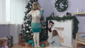 cierge magique : Three girls enjoyed the gifts under the Christmas tree