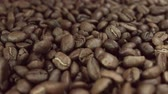 еда и питье : Coffee grains fall in slow motion