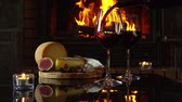 темно бордовый : Red wine is poured into glasses on the background of snacks around fireplace Стоковые видеозаписи