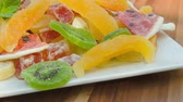 caju : Plate of nuts and candied fruit kiwi, orange, watermelon, mango and pineapple