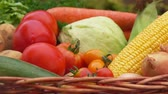 saŁata : Still life with vegetables - corn, tomatoes, potatoes and onions in the basket Wideo