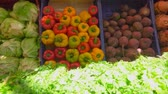 melão : Bright juicy fresh greens and vegetables on a beautifully decomposed showcase in the vegetable market Stock Footage