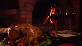 kabarcıklı : Celebratory dinner by the fireplace. Panorama from top to bottom on a table with glasses of red wine.