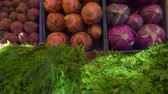 red cabbage : Bright juicy fresh greens and vegetables on a beautifully decomposed showcase in the vegetable market Stock Footage