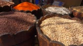 kidney beans : Different types of legumes are in barrels in the Eastern market