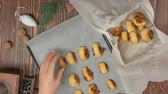 baked : Top view on hand takes Italian Fig Cookies Cucidati from a pan and puts them in a Christmas box