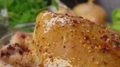 marináda : Close-up of spices falls on the chicken in slow motion