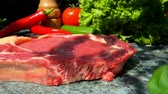 biber tanesi : Veal steak falls on a green marble table. Still life of meat, herbs, spices and vegetables Stok Video