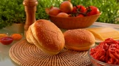 베이컨 : Hamburger bun falls on the table. On the table prepared products for burgers