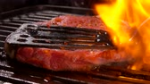 перчинка : Tasty pork steak flipping on the grill. Steak is pressed by kitchen spatula to the grill