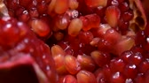 garnet : Grains fall into a large juicy red pomegranate Stock Footage