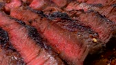 carne de porco : Panorama on finished juicy beef steak sliced on a wooden board Stock Footage