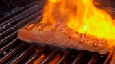Salmon fillet steak is grilled on a grill over an open fire.