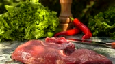 перчинка : Veal steak falls on a green marble table. Still life of meat, herbs, spices and vegetables Стоковые видеозаписи