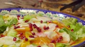 rúcula : Beautiful plate on a close-up of a salad with vegetables and pomegranate seeds
