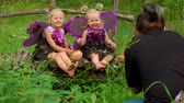 borboletas : Photographer takes pictures of girls playing butterflies. Girls wear butterfly wings