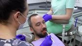 diente : Dentist checks the quality of the dental filling with special tools Archivo de Video