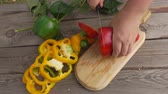 ringen : Hands chop red pepper on a wooden board in slow motion Stockvideo