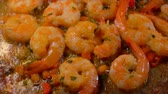 champanhe : Delicious shrimps stewed in a spicy sauce with herbs in a pan. Shrimp Recipe