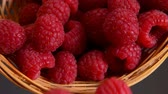 vime : Large juicy mouth-watering raspberries falling from a wicker basket