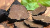 vůně : Close up of a rare black truffle fungus cutted into pieces. Panoramic view of a texture of a black truffle