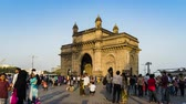 Махараштра : Tourist come to visiting the Gateway of India and taking photo, this is the travel destination in Mumbai India, 4K Time lapse