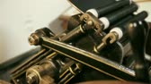 engenharia : close up of moving parts of an antique letterpress Stock Footage