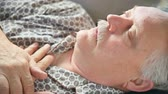 pijama : A man suffering from a cold or flu lying down Stock Footage