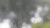 room for text : Rain flows from a gutter outside while raindrops collect on a window. Stock Footage