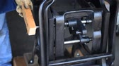 mecanismo : Printer pushes a metal rod into an antique printing machine Stock Footage