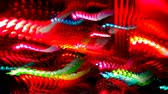 fundo colorido : Multi-colored lights dance across the screen Stock Footage