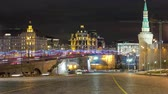 silence : Bolshoy Moskvoretsky Bridge with car traffic at winter night timelapse, view from Red square Moscow 4K