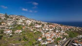 roof : View from the mountain over the rooftops from cable car on Madeira timelapse hyperlapse.  The modern landscape. Funchal, Portugal. 4K